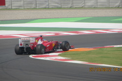 Alonso hitting the apex at turn 1