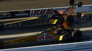 Leah Pritchett pilots the Papa John's TF dragster past Tony Schumacher, Feb. 12