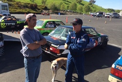 Brad McClure discusses the upcoming race with a fan