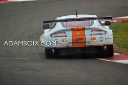 Aston #95 attacking the kerbs at Becketts