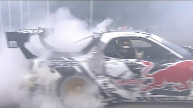 Mad Mike Whiddet drifts his RX7 in the paddock. One handed.