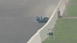 Joe DeSantis crashes into the wall in Indy