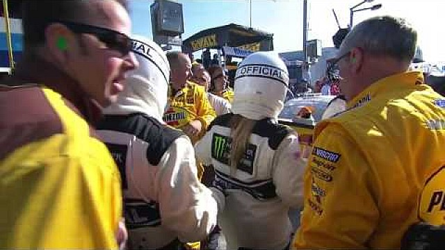 Fight: Kyle Busch restrained after punching Joey Logano
