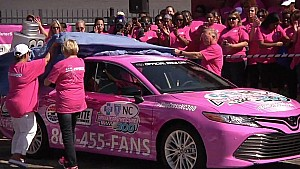 Nascar stars paint the wall pink at Charlotte Motor speedway